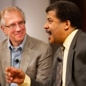 Nobel laureate Thomas Cech looks on as astrophysicist Neil deGrasse Tyson addresses high school students at the Howard Hughes Medical Institute. Chevy Chase, MD.